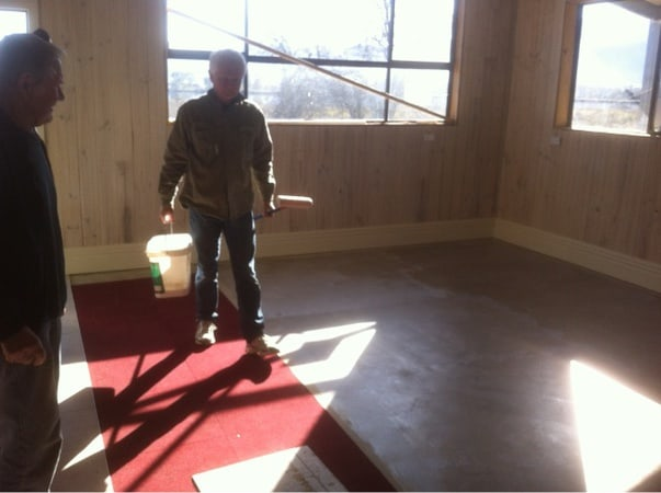 Doug Hamilton laying carpet tiles