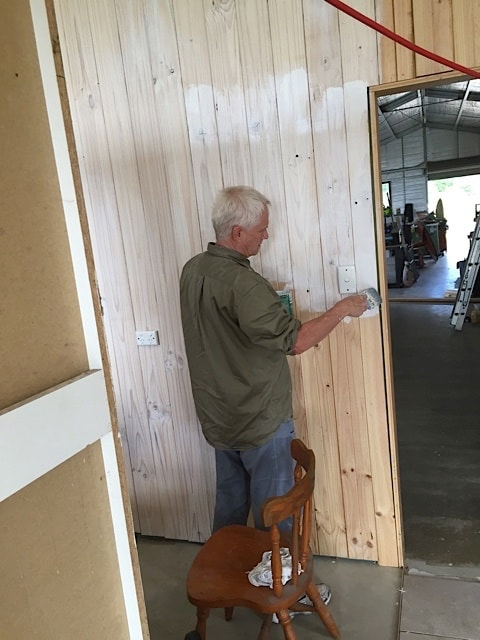 Doug Hamilton liming the pine timber walls