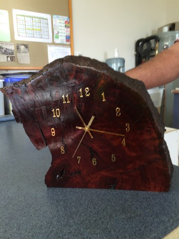 — Shed Clock Project —Clock face inserted into a beautifully prepared redgum base. Clock can be displayed standing or hanging on a wall. It is for sale and can be viewed at the Shed. Price $75.00. (Made by Ken Halse)