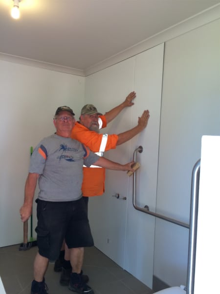 Shower Lami Panel install. From left: Rod Hyde & Mark Hardidge