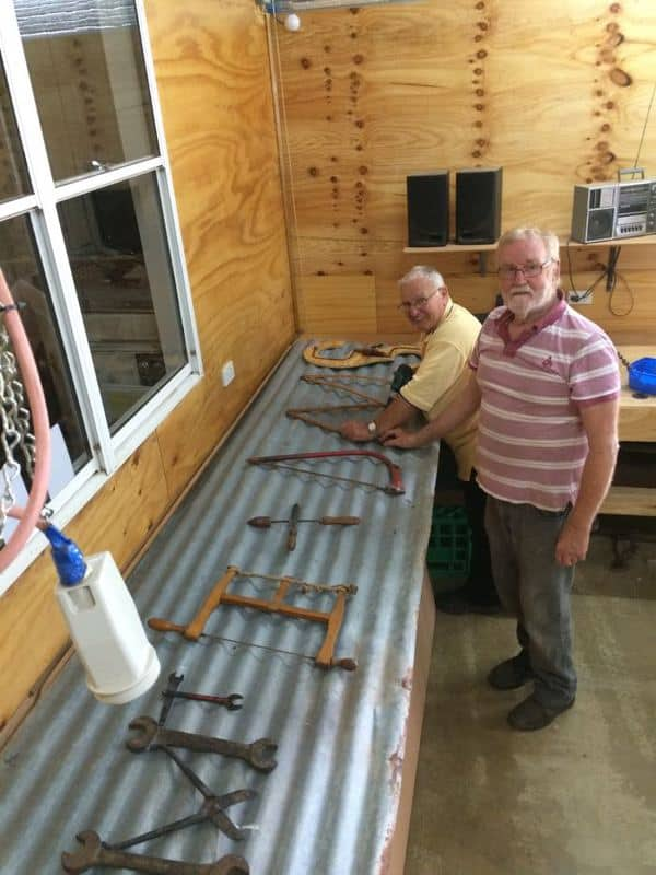 Mal Darwent (front) & Ken Halse designing the Acronym sign made from old tools