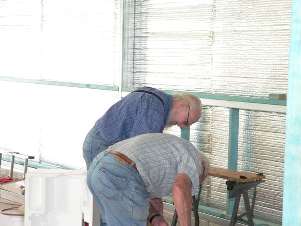 Ian Sharp & Reg Hollands framing the walls