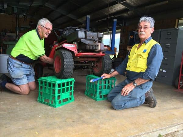 NH Centre mower repairs: Left: Reg Hollonds & Barry Hinson