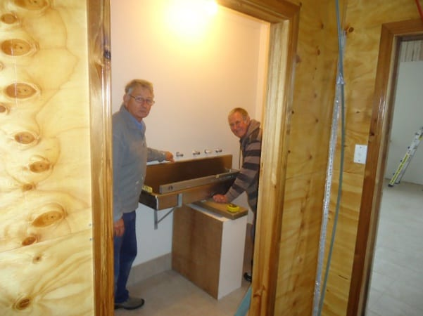 Rod Hyde & Lindsay Ikin installing the wash trough